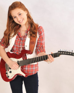 Sarah looking cool with her red electric guitar